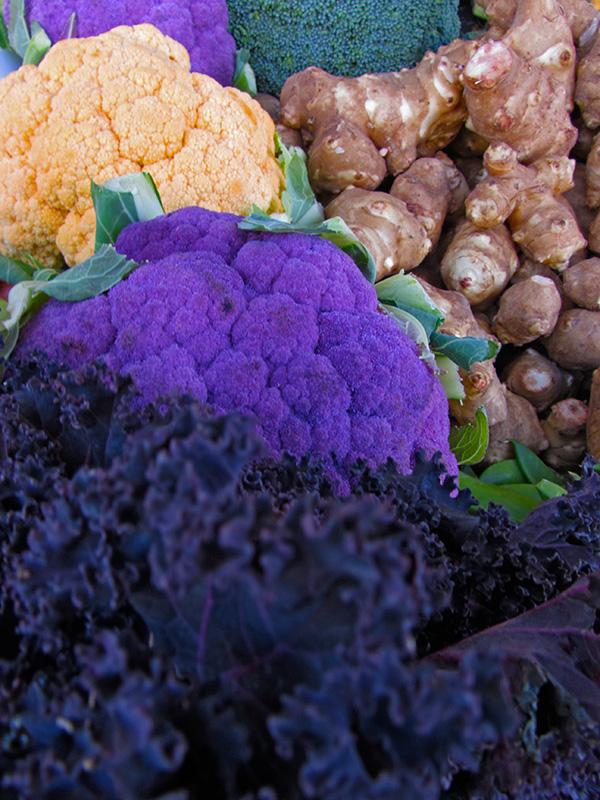 purple cauliflower, orange cauliflower, purple kale, jerusalem artichokes, and broccoli